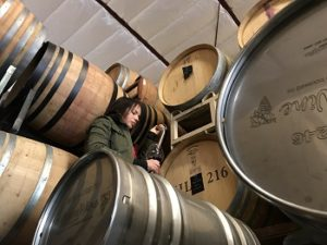 Winemaker Mary Bradley taking a barrel sample.