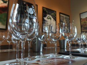 Inside Tablas Creed Vineyard tasting room. Glasses setup for wine tasting.