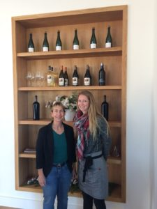Kara from 805 Wine Country in front of some of the Biddle Ranch wines with tasting room host Sara.