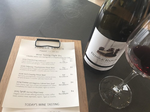 A view in time at the Biddle Ranch Winery tasting menu along side a bottle of 2016 SLO County Pinot Noir.