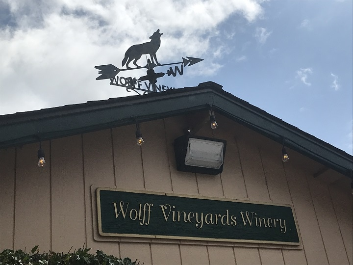 Wolff Vineyards building at the winery with wolf shaped weather vane