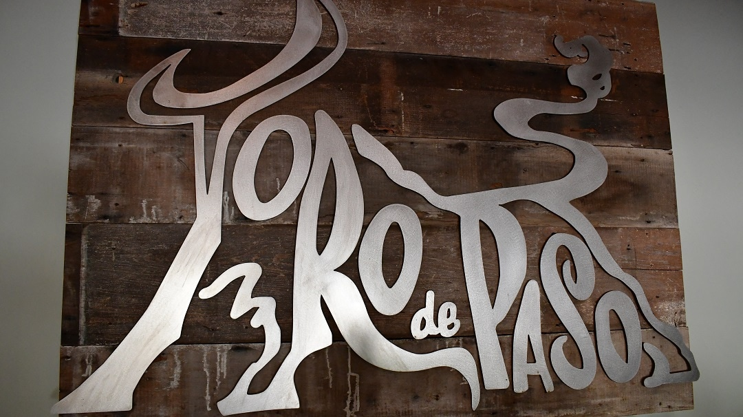 The unique Toro de Paso metal sign in the Bodega de Edgar tasting room in Paso Robles