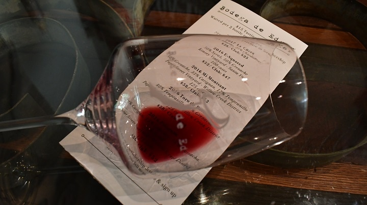 A tilted glass of red wine from Bodega de Edgar Winery in Paso Robles